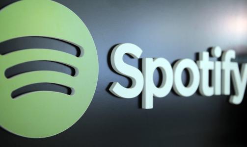 在Spotify的音乐应用通常采用黑色和绿色的配色方案